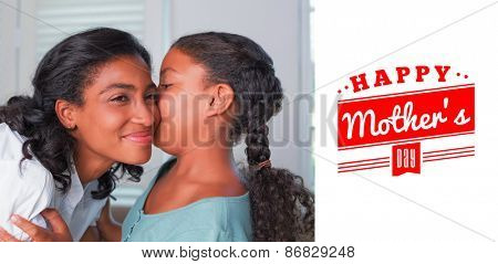 mothers day greeting against mother and daughter hugging on the couch