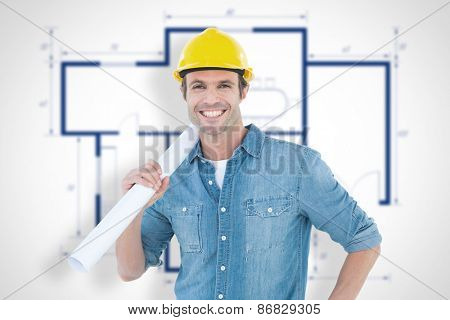 Confident architect holding rolled blueprint against blueprint