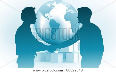 Smiling young businessmen shaking hands in office against planet on grey background with cubes