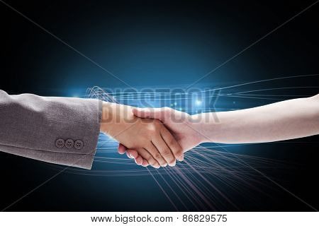 Handshake between two women against blue abstract design