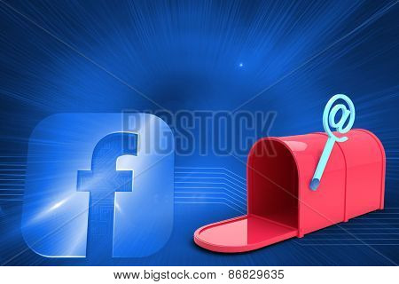 Red email post box against glowing social media sign in left corner