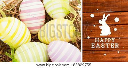 happy easter graphic against overhead of wooden planks