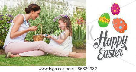 Mother and daughter collecting easter eggs against happy easter