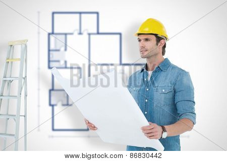 Architect holding blueprint in house against blueprint