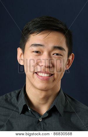 Young Asian man smiling and looking at camera