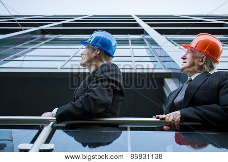 Engineer Team Watching Over Building Site
