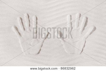 Two hands print in the sand. Concept for memories or vacation items.