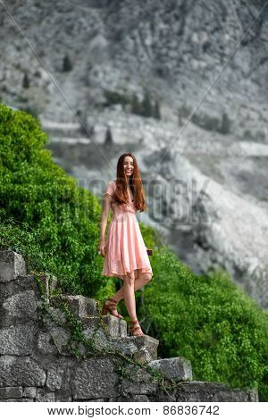 Woman going down stairs with beautful nature background
