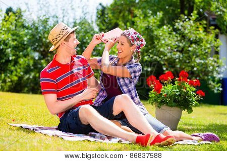 Couple having argument in garden