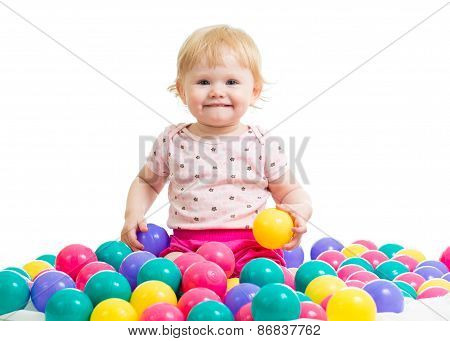 Little girl in ball pit woth colored balls