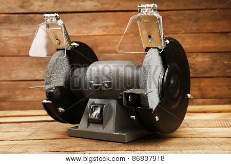 Knife sharpener on wooden background