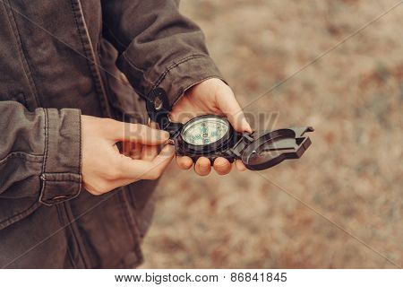 Hiker Holding A Compass Outdoor