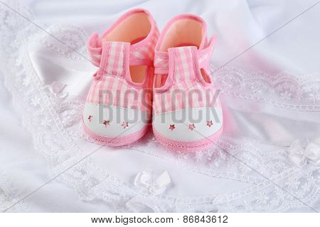Booties on cloth background