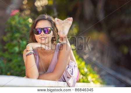 Portrait of attractive young girl on a sunny summer day