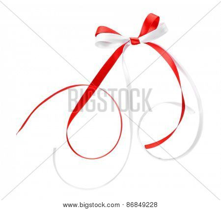 Colorful red and white ribbons with bow isolated on white