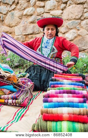 Cuzco, Peru - July 15, 2013: woman selling handcraft in the peruvian Andes at Cuzco Peru on july 15th, 2013