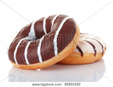 Delicious donuts with icing isolated on white