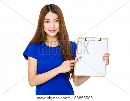 Young woman show with blank clipboard