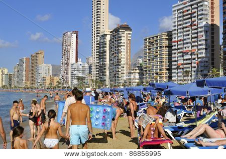 BENIDORM, SPAIN - SEPTEMBER 23: Vacationers in Levante Beach on September 23, 2014 in Benidorm, Spain. Also known Beniyork because of the skyscrapers is a major beach destination for European tourism