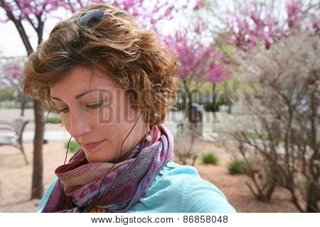 Woman in park with blooming flowers