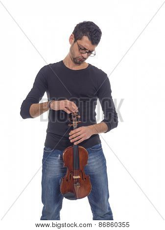 Portrait of a violinist in jeans over white background