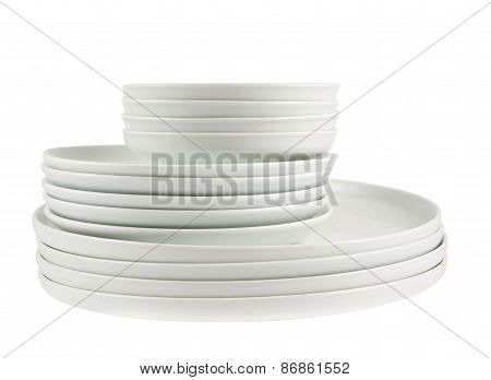 Pile of clean white dish plates isolated