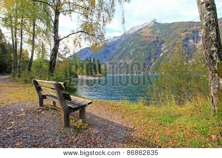 A bench along the Achensee Lake during Autumn in Tirol, Austria.