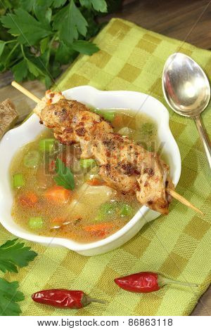 Poultry Consomme Soup With Green And Bread