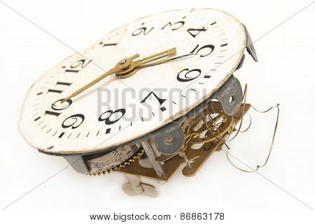 Old Alarm Clock With Mechanical Exploded Charging On A White Background.