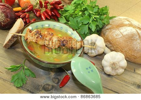 Poultry Consomme With Chicken Skewer And Greens