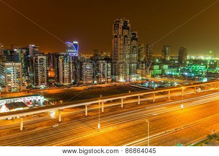 DUBAI, UAE - APRIL 3, 2014: Technology park of Dubai Internet City at night. Dubai Internet City is created by the government free economic zone for global information technology firms.