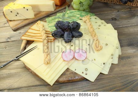 Slices Of Cheese With Grapes