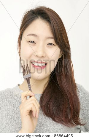 Attractive asian woman with fork