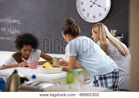 Female Friends Enjoying Breakfast Whilst Checking Mobile Phones