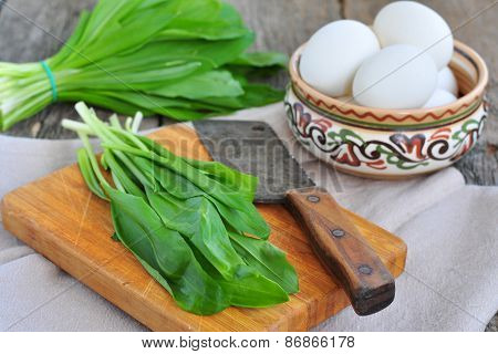 Green chopped eggs salad with potato, ramson and parmesan cheese