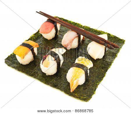Nigirizushi sushi over nori sheet