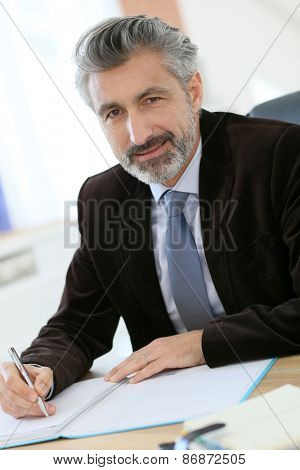 Portrait of notary in office