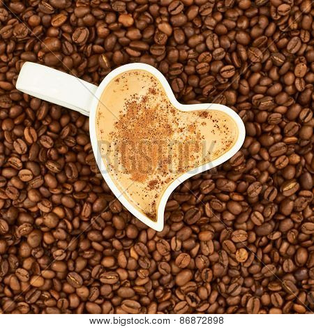 Filled cup on coffee beans