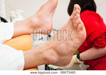 pedicure male feet in a modern beauty salon
