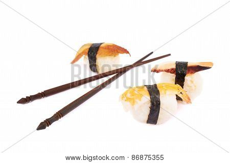 Sushi and chinese sticks composition