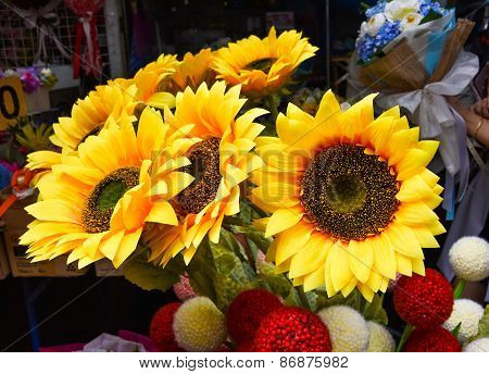 Artificial Sunflower On Sale On The Street Market Of Thailand