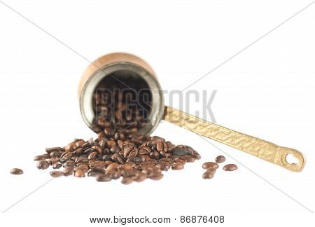Copper cezve and coffee beans