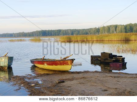 lake with boats on shore