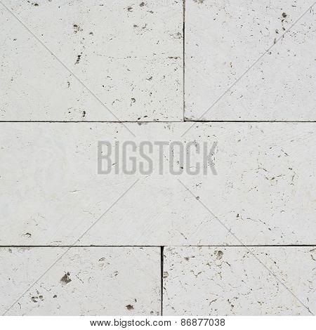 White limestone brick wall's fragment