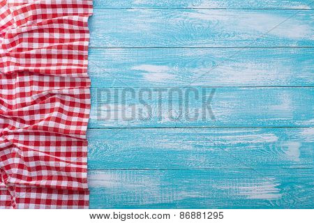 Wooden Table Covered With Tablecloth Cloth Checkered Red.