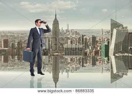 Businessman looking through binoculars against room with large window looking on city
