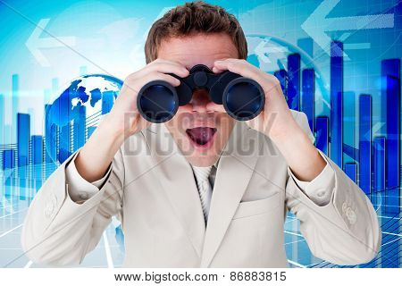Positive businessman using binoculars against global business graphic in blue