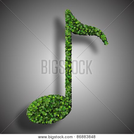 Musical note eight symbol made from green leaves isolated on white background.