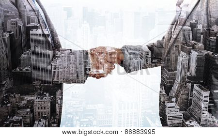 Close up on two businesspeople shaking hands against high angle view of city