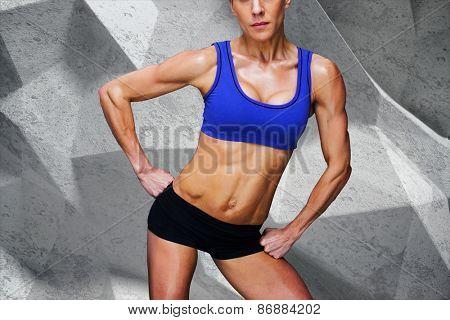 Female bodybuilder against grey angular background